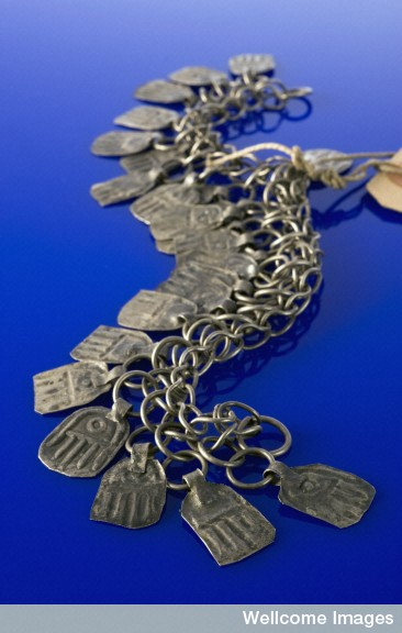 L0057649 Part of a silver necklace decorated with the 'hand of Fatima