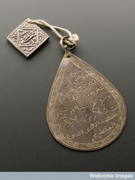 L0057456 Silver pear shaped pendant with silver square rupee, Middle