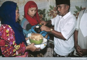 N0026600 Life in rural Indonesia. Blessing the child.