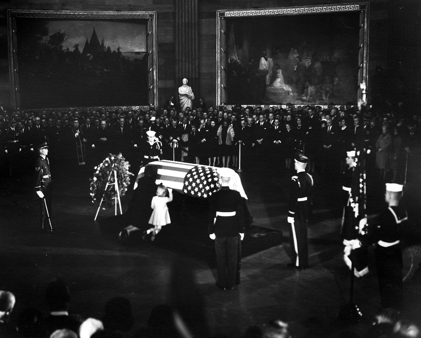 November 1963 : President Kennedy's wife and daughter kneel at the casket as the President's body lies in state in the Rotunda of the Capitol Building.  Photo credit: Abbie Rowe, National Park Service / John Fitzgerald Kennedy Library, Boston.