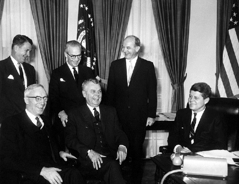 President John F. Kennedy meets with Prime Minister John G. Diefenbaker of Canada in the Oval Office, White House, Washington, D.C. (L-R) Seated: President Kennedy; Prime Minister Diefenbaker; Secretary of State for External Affairs of Canada Howard C. Green. (L-R) Standing: Secretary of State Dean Rusk; Canada Ambassador to the United States Arnold (A.D.P.) Heeney; United States Ambassador to Canada Livingston T. Merchant.Abbie Rowe. White House Photographs. John F. Kennedy Presidential Library and Museum, Boston