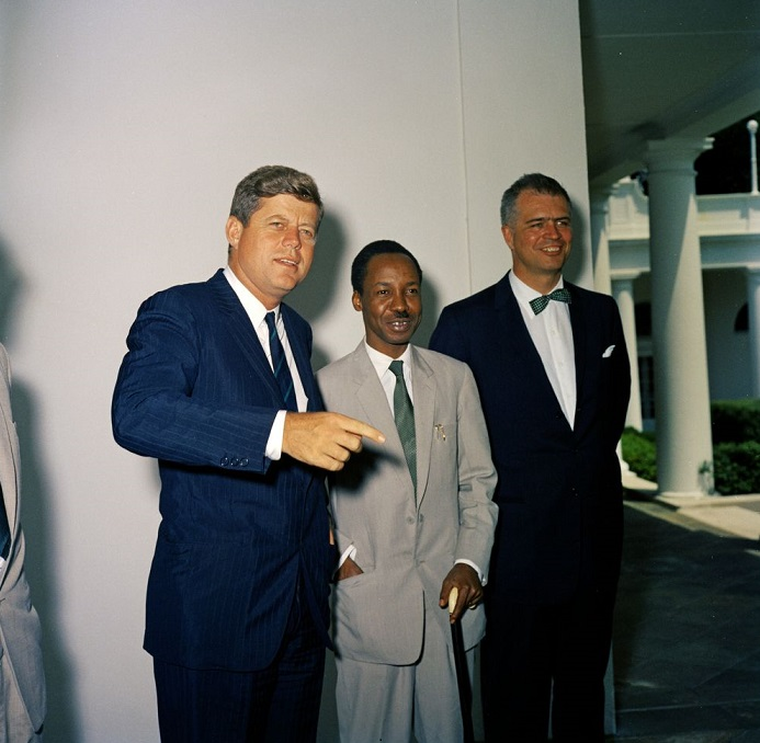 "17 July 1961: President John F. Kennedy is seen with Prime Minister Julius Nyerere of Tanganyika at the West Wing Colonnade, White House, Washington, D.C. Also in picture is Assistant Secretary of State for African Affairs G. Mennen ""Soapy"" Williams. Photo credit: Robert Knudsen. White House Photographs. John F. Kennedy Presidential Library and Museum, Boston"