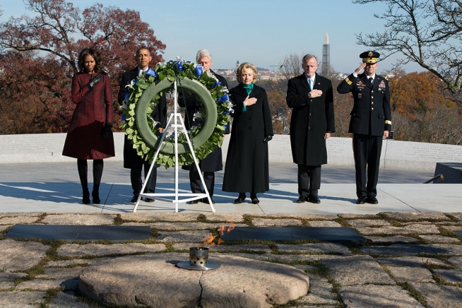 President Barack Obama, First Lady Michelle Obama, former President Bill Clinton and former Secretary of State Hillary Rodham Clinton participate in a wreath laying ceremony at the gravesite of President John F. Kennedy at Arlington National Cemetery in Arlington, Va., Nov. 20, 2013.  Photo: credit: Official White House Photo by Pete Souza