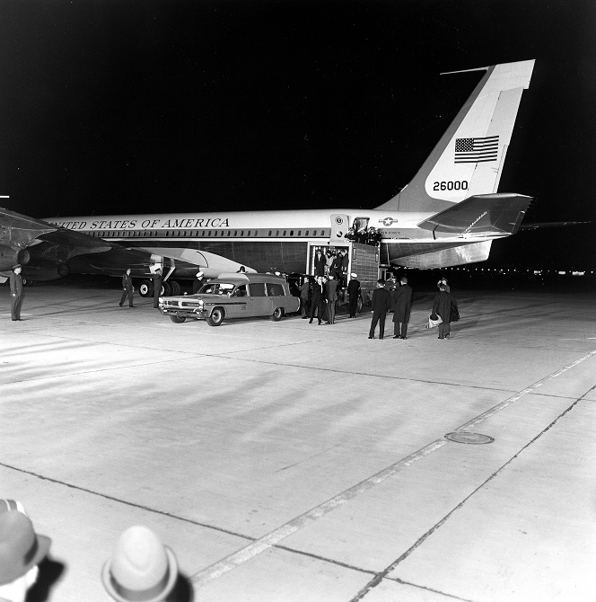 22 November 1963: President Kennedy's remains return from Dallas and are unloaded from Air Force One into a Navy Ambulance as Attorney General Robert F. Kennedy, First Lady Jacqueline Kennedy and many others and many others look on. Andrews Air Force Base, Maryland. Photo credit: Cecil Stoughton. White House Photographs. John F. Kennedy Presidential Library and Museum, Boston.