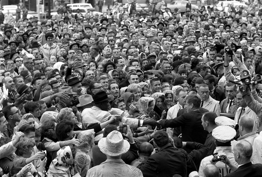 22 November 1963: President Kennedy reaches out to the crowd gathered at the Hotel Texas Parking Lot Rally in Fort Worth, TX,. Photo credit: Cecil Stoughton. White House Photographs. John F. Kennedy Presidential Library and Museum, Boston. Scanned from original 35mm neg