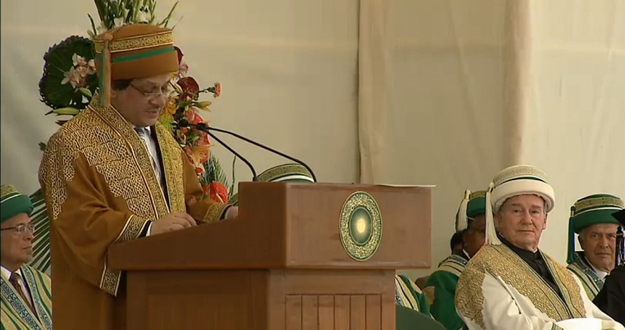 The Chief Guest, Dr Ishrat Ul Ebad Khan, the Governor of Sindh addressing the gathering at the 2013 Convocation of the Aga Khan University. The robe worn by the Chief Guest  is decorated with rich gold embroidery on a teak brown background. The headgear is brown in colour with a gold embroidered 5.5 cm band and a 2 cm wide secondary green band and a green and teak brown tassel.