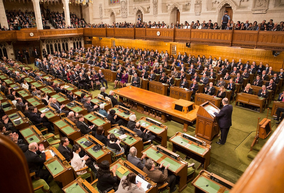 His Highness the Aga Khan seen addressing at the House of Commons Chambers to both the houses of Canadian Parliament on Thursday, February 27, 2014. Photo credit: The Office of the Prime Minister of Canada.