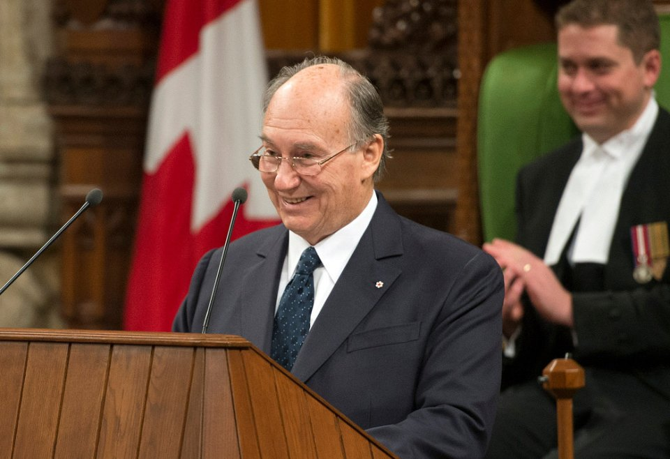 "His Highness the Aga Khan seen smiling in a lighter moment during his address to both the Houses of the Canadian Parliament on Thursday, February 27, 2014. Referring to the two gold medals won by the Canadian hockey teams in the Sochi Olympics, the Ismaili Imam remarked, ""As an ex-player myself I was hoping you would require your honorary citizens to join your team. I am convinced that the Dalai Lama and I would have been a formidable defence."" Photo credit : The Office of the Prime Minister of Canada."