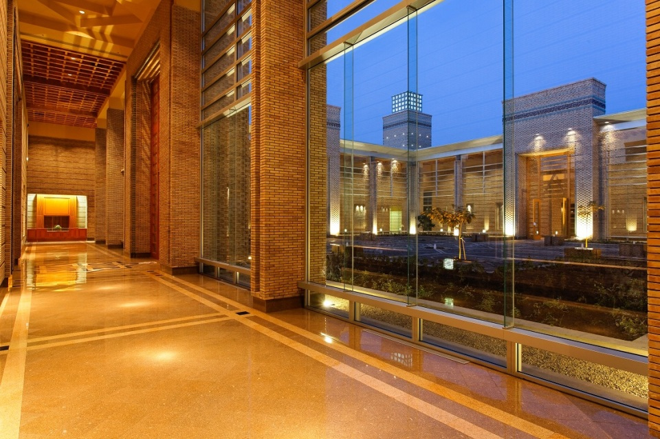 A view at night from hallway of the Ismaili Centre Dushanbe into the great court. Photo: FNDA Architecture Inc. Copyright.
