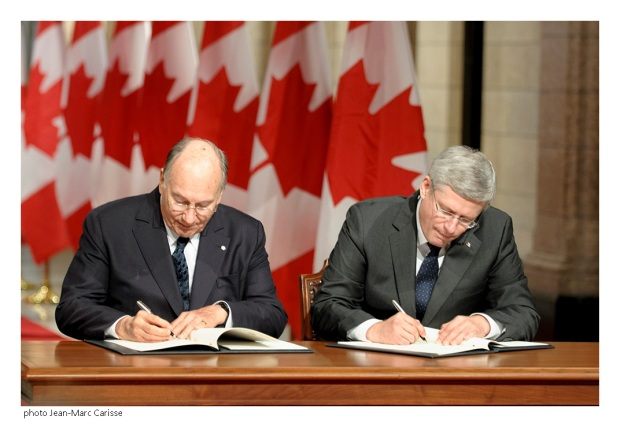 His Highness the Aga Khan and Prime Minister Stephen Harper sign a Protocol of Understanding further strengthening the ongoing platform of cooperation between the Ismaili Imamat and Canada. Photo: Jean-Marc Carisse. Copyright.