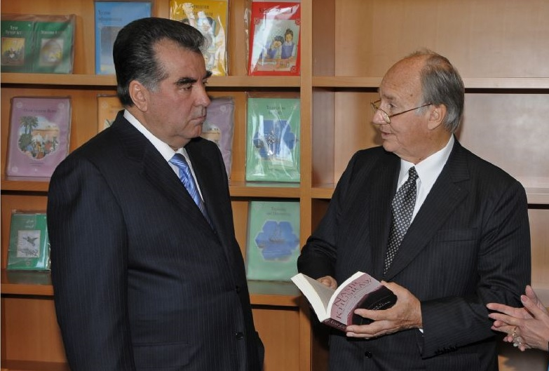 "President Rahmon and His Highness the Aga Khan pause in the library of the new Ismaili Centre in Dushanbe. They engage over Alice Hunsberger's ""The Ruby of Badakhshan"", a fascinating study about the renowned poet and Ismaili philosopher, Nasir Khusraw, who lived over a thousand years ago in the region that is modern Tajikistan. Photo: Moez Visram/The Ismaili."