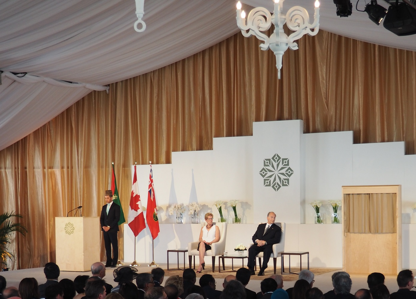 Mawlana Hazar Imam, Premier Kathleen Wynne and the reciter of the Holy Qur'an, Ahsan Afzally, look on as a translation of the Qur'anic verses in English and French is underway during the opening ceremony of the Aga Khan Park on May 25, 2015. Photo: Simerg/Malik Merchant. Copyright.