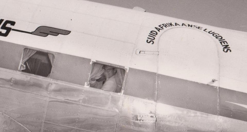 In May 1958, Mawlana Hazar Imam, His Highness the Aga Khan, 49th Imam of Shia Imami Ismaili Muslims, visited his followers in South Africa, Mozambique and Madagascar. Here he is seen waving from a South African Airways plane as he departs the former Portuguese colonial city of Lourenço Marques (now Maputo), Mozambique, following a 3 day visit. Photo: Jehangir Merchant collection