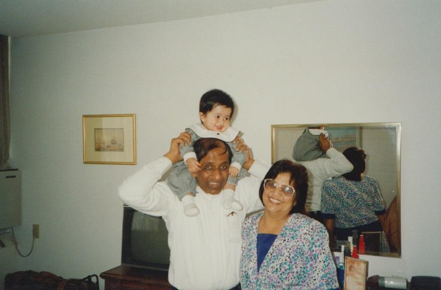052 Nurin enjoying a shoulder lift by her grandfather Alwaez Merchant