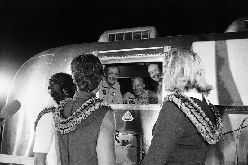 40147_Apollo 11 astronauts, still in their quarantine van, are greeted by their wives upon arrival at Ellington Air Force Base