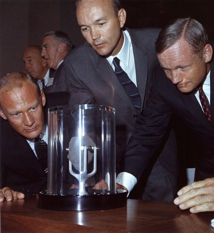 ap11-69-HC-967_Apollo 11 astronauts examine a lunar sample