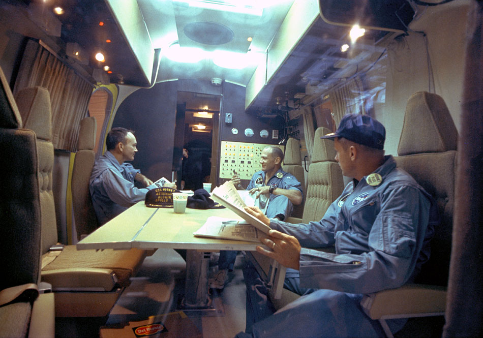 ap11-KSC-69PC-485_The Apollo 11 crew relaxes in the quarantine van