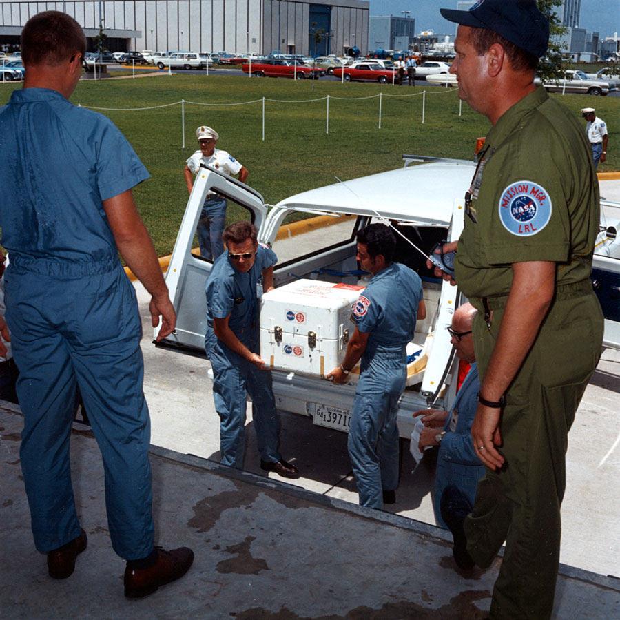ap11-S69-39996_The first Apollo 11 sample return container, containing lunar surface material, is unloaded at the Lunar Receiving Laboratory, bldg 37, Manned Spacecraft Center.