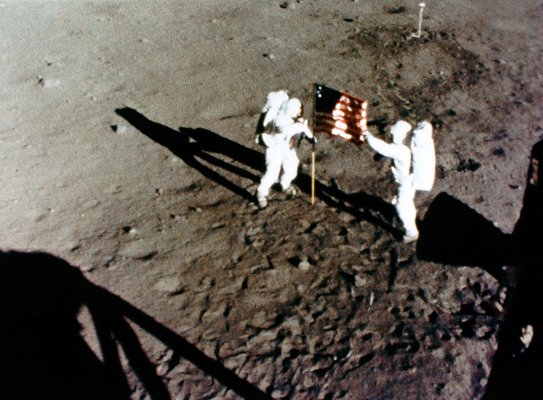 ap11-S69-40308_Armstrong and Aldrin set up USA flag