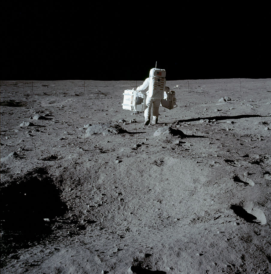 AS11-40-5944_Aldrin with experiment packages