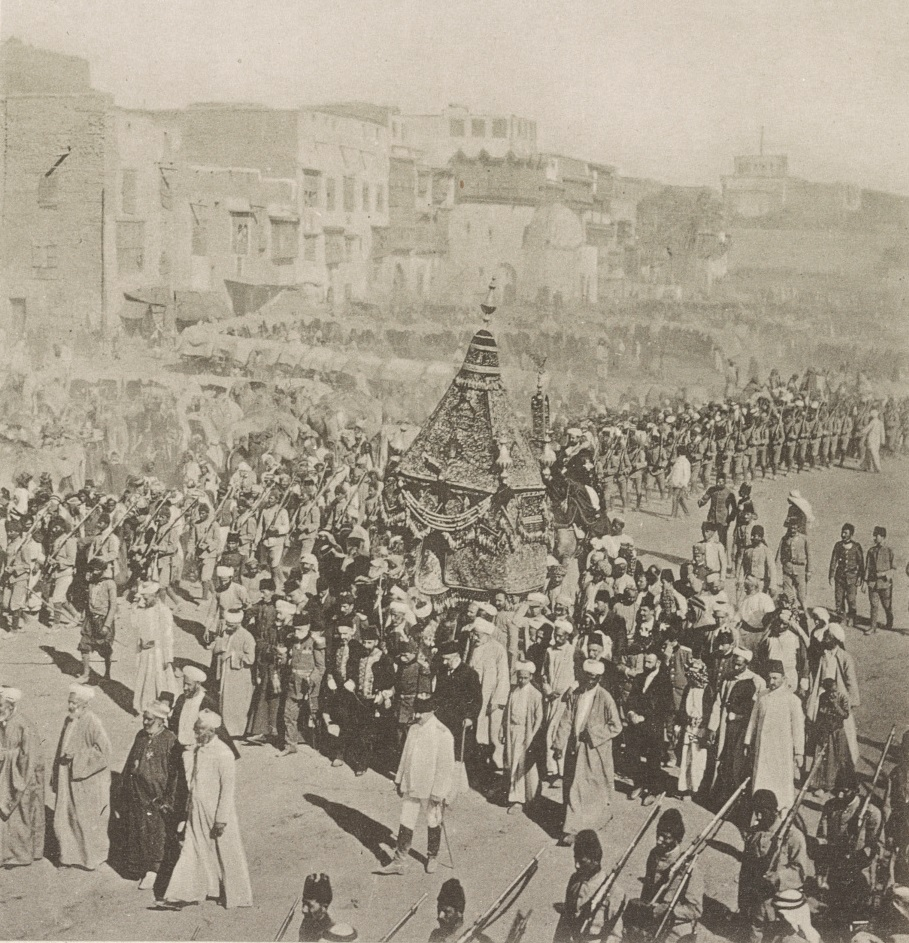 38159v_a view of a caravan of dignitaries and soldiers with the palaquin Mahmal in al-Manākha Square on its way to Mecca for the Hajj
