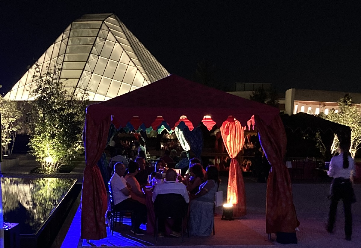 Garden Party Aga Khan Museum and lit up dome of Ismaili Centre, Simerg