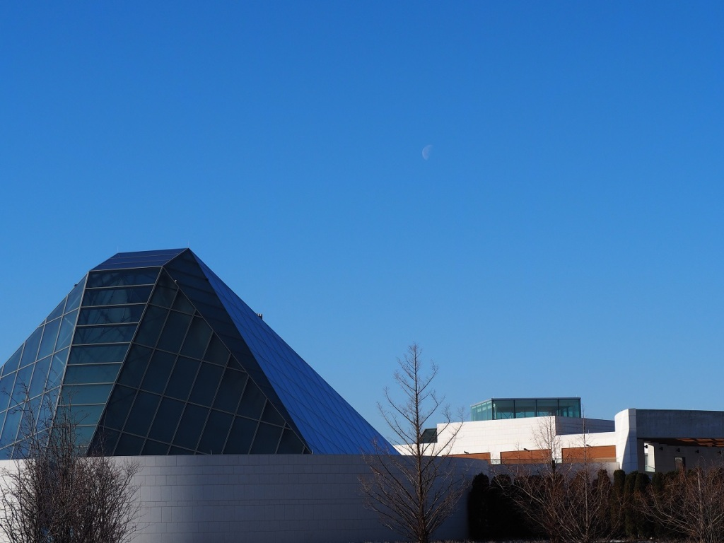 Third quarter daytime moon Ismaili Centre and Jamatkhana.