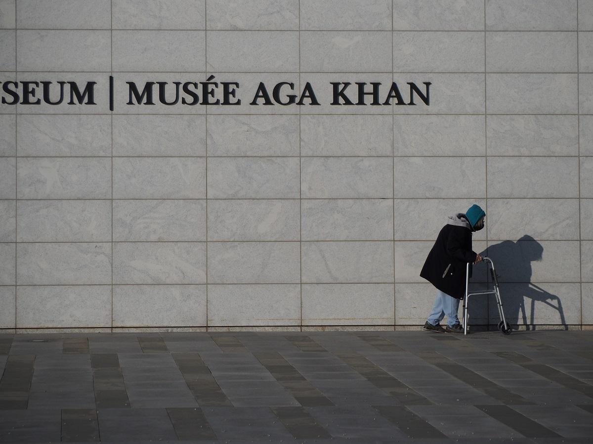 senior citizen at Aga Khan Museum pushing her walker, simergphotos malik merchant