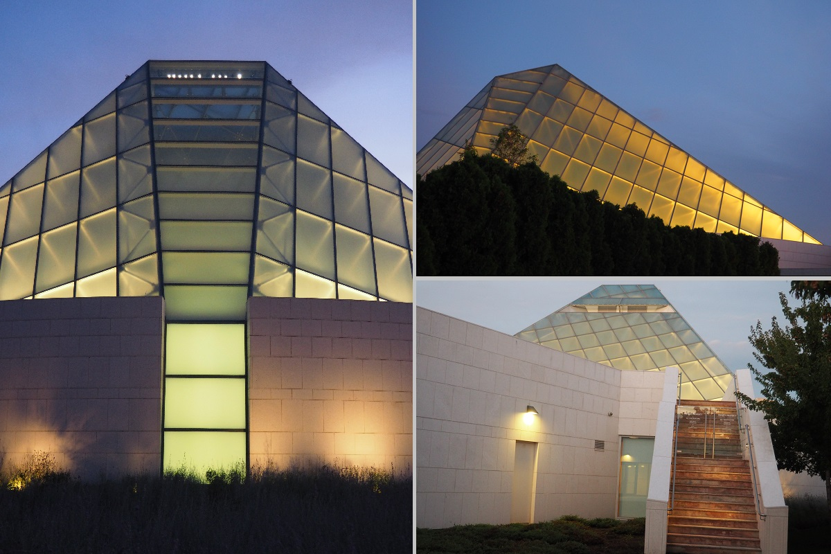 The lit-up crystalline glass dome of the Ismaili Headquarters Jamatkhana, part of the Ismaili Centre Building.